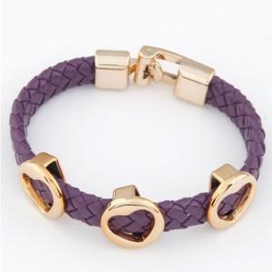 Фиолетовый кожаный плетёный браслет «Сердечки» с тремя золотистыми сердцами купить. Цена 50 грн или 160 руб.