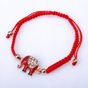 Красный браслет из плетёной нити с красным слоником со стразами купить. Цена 69 грн