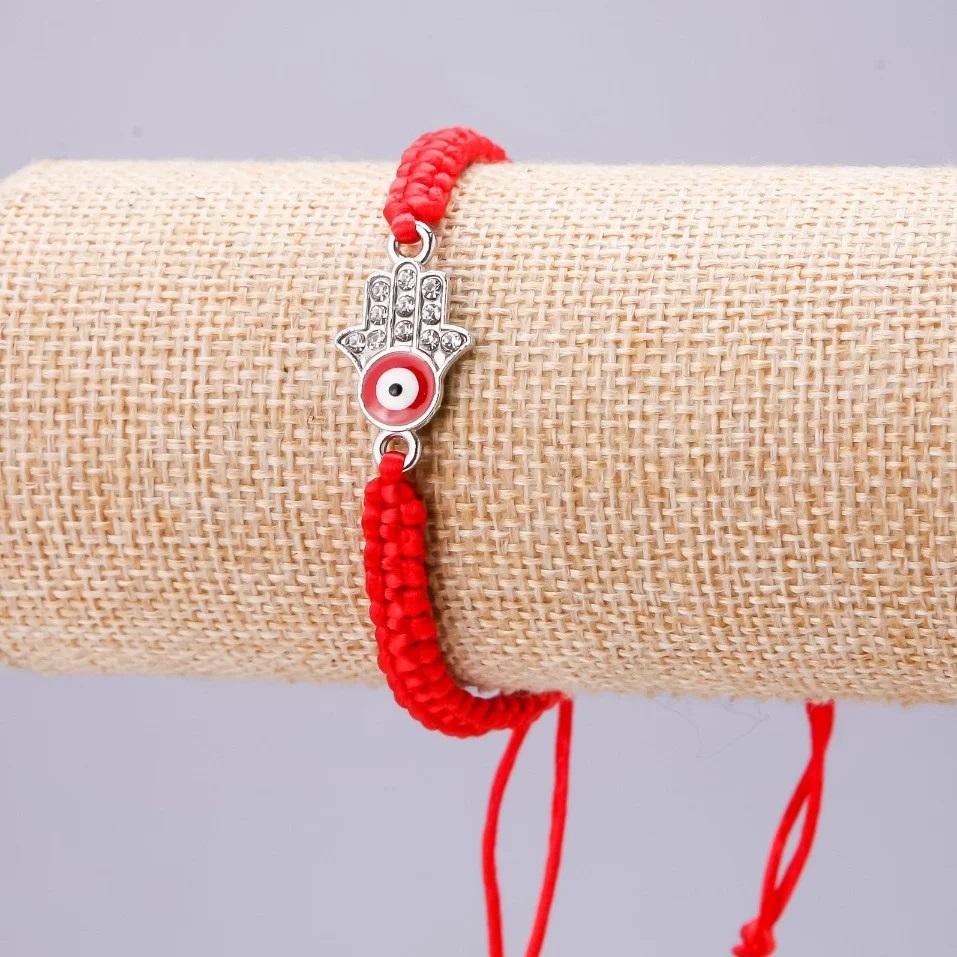 Популярный браслет-амулет «Хамса» в виде плетёной красной нити купить. Цена 49 грн