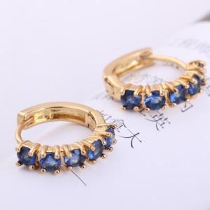 Великолепные серьги-дуги с золотым покрытием и синими камнями (фианитами) фото. Купить