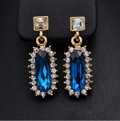 Нарядные висячие серьги «Венские» с крупным голубым камнем из горного хрусталя и бесцветными стразами купить. Цена 135 грн