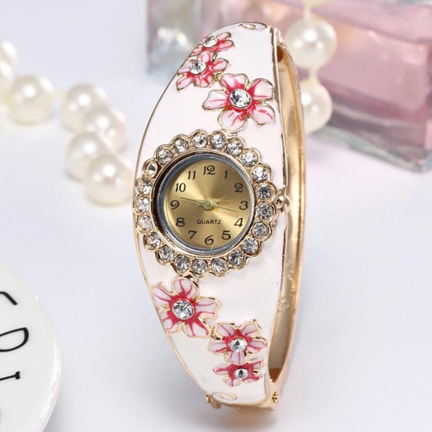 Летние часы-браслет «Quartz» с белой эмалью и цветами со стразами купить. Цена 299 грн
