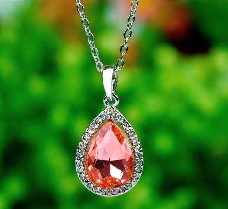Каплевидная подвеска «Алмаз» с крупным оранжевым кристаллом в серебристой оправе купить. Цена 185 грн