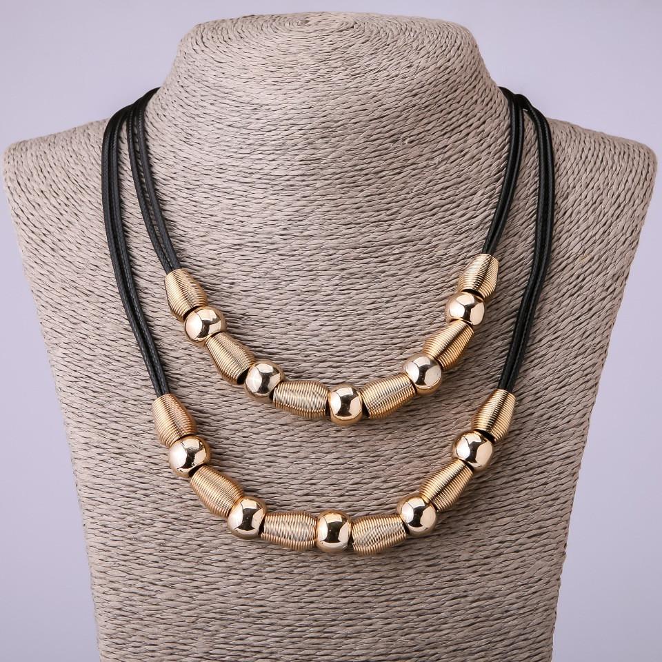 Красивое ожерелье «Хамураппи» с золотыми бусинами на чёрном шнурке купить. Цена 235 грн