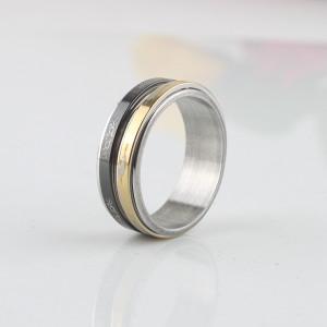 Стальное кольцо «Luxury» с подвижными вставками из металла золотого и чёрного цветов купить. Цена 180 грн или 565 руб.