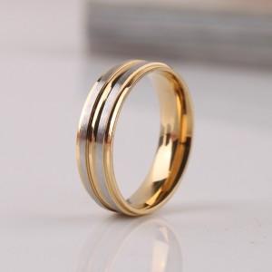 Жёлтое кольцо «Luxury» без вставок из хирургической стали с серебристыми рельефными полосами купить. Цена 180 грн