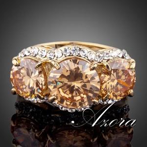 Массивное кольцо «Сокровище» (бренд-AZORA) с тремя камнями Сваровски янтарного цвета купить. Цена 290 грн или 910 руб.