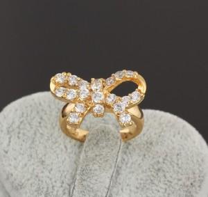 Милое колечко в виде банта с цирконами и золотым покрытием арабским золотом купить. Цена 160 грн
