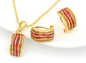 Изумительный комплект «Сахара» с серьгами и кулоном с красной и золотой эмалью, без камней фото. Купить
