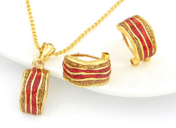 Изумительный комплект «Сахара» с серьгами и кулоном с красной и золотой эмалью, без камней купить. Цена 275 грн