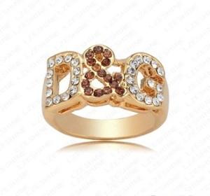Модное кольцо «D&G» с коричневыми и бесцветными стразами на буквах купить. Цена 135 грн или 425 руб.