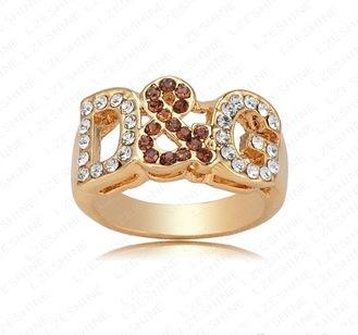 Модное кольцо «D&G» с коричневыми и бесцветными стразами на буквах купить. Цена 135 грн
