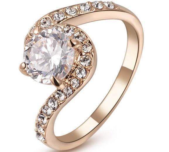 Красивое кольцо «Вьюга» с круглым цирконом и покрытием из розового золота купить. Цена 250 грн