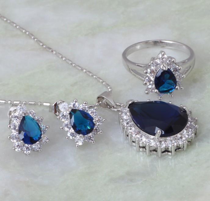 Очаровательный комплект «Симфония» с серьгами, кольцом и кулоном с синими цирконами и платиновым покрытием купить. Цена 530 грн
