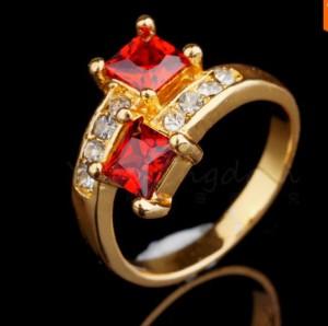 Изящное кольцо «Риголетто» с красными камнями и бесцветными стразами купить. Цена 135 грн или 425 руб.