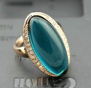 Эксклюзивное кольцо «Адриатика» с большим камнем цвета морской волны и позолотой купить. Цена 375 грн