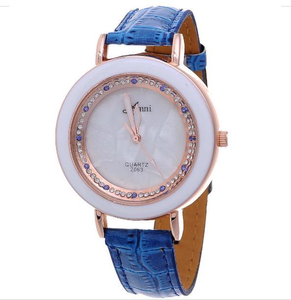 Кварцевые женские часы «Amni» белого цвета со стразами на синем ремешке купить. Цена 190 грн