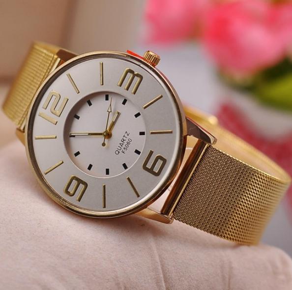 Классические кварцевые часы с металлическим браслетом золотого цвета купить. Цена 299 грн