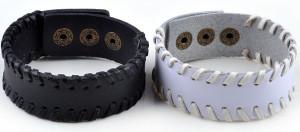 Обычные кожаные браслеты чёрного и белого цвета на застёжке-кнопке купить. Цена 115 грн или 360 руб.