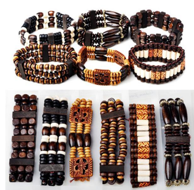 Недорогие браслеты из дерева с круглыми, квадратными и продолговатыми бусинами на резинке купить. Цена 49 грн
