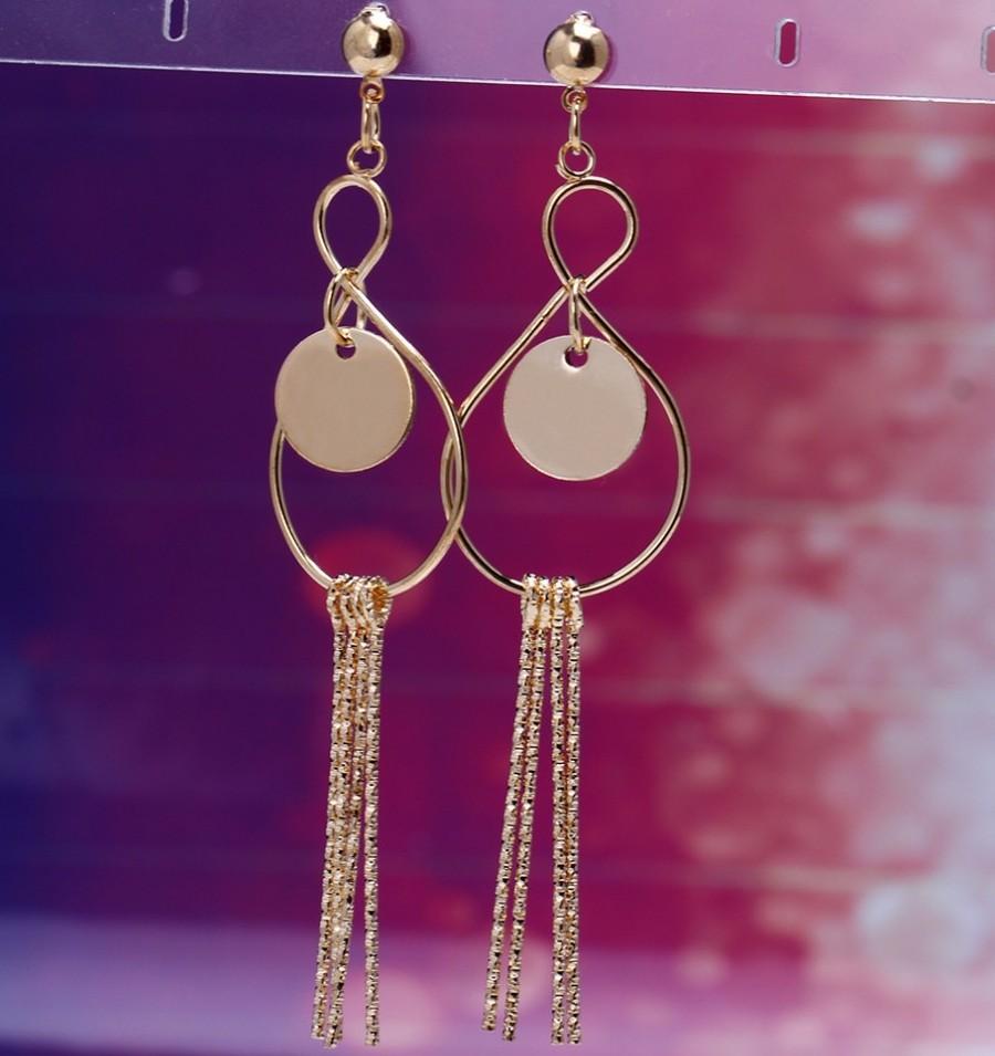Длинные висячие серьги «Эльдорадо» в бразильском стиле с покрытием под золото, без камней купить. Цена 99 грн
