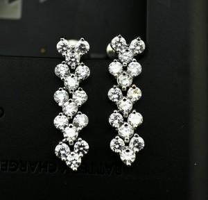 Свадебные серьги «Церемония» (бренд-UMODE) с цирконами и напылением из белого золота купить. Цена 230 грн