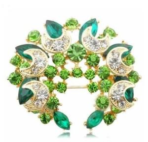 Нарядная зелёная брошь «Венец» со стразами и покрытием под золото купить. Цена 100 грн