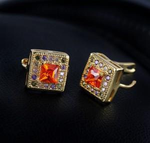 Квадратные серьги с оранжевым камнем, позолотой и английской застёжкой фото. Купить