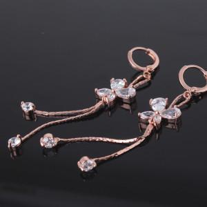 Висячие серьги «Сатурнии» с бабочками, фианитами и напылением из розового золота купить. Цена 265 грн или 830 руб.