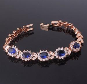 Ювелирный браслет «Топазы» с синими камнями-цирконами и 18-ти каратным золотым покрытием фото. Купить