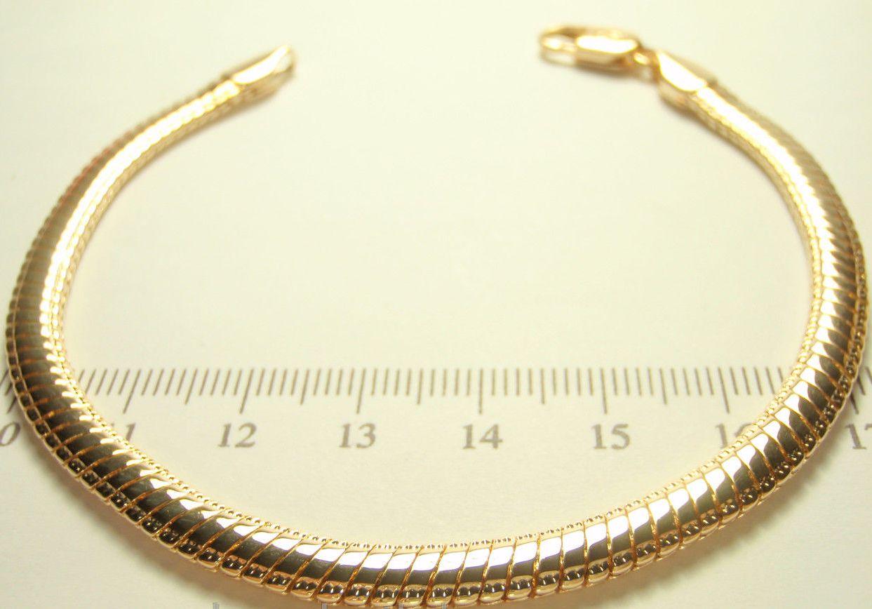 Красивый браслет с плотным плетением змейка и золотым покрытием купить. Цена 230 грн