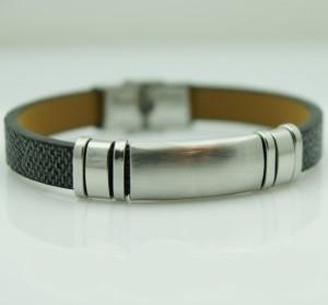 Стильный мужской браслет из заменителя кожи с гладкими стальными вставками купить. Цена 145 грн