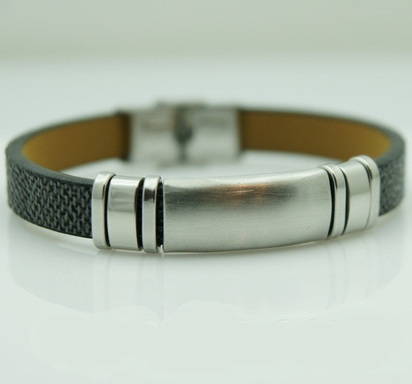 Стильный мужской браслет из заменителя кожи с гладкими стальными вставками купить. Цена 165 грн