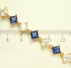 Позолоченный браслет «Эсмеральда» с синими и бесцветными камнями квадратной формы купить. Цена 360 грн