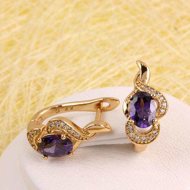 Грациозные серьги «Веста» с овальным камнем фиолетового цвета купить. Цена 185 грн