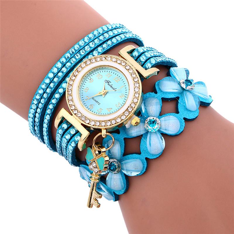Нежные часы «Fulaida» с голубым ремешком с акриловыми цветами купить. Цена 295 грн