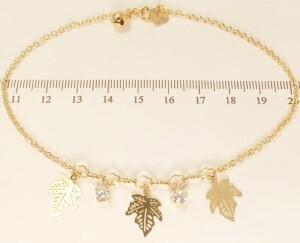 Позолоченный браслет на ногу в виде цепочки с кулонами в форме листьев фото. Купить
