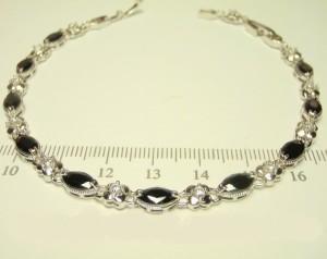 Милый браслет «Симфония» с чёрными цирконами в серебристой оправе фото. Купить