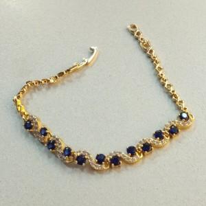 Потрясающий браслет «Медея» с позолотой и синими и бесцветными цирконами фото. Купить
