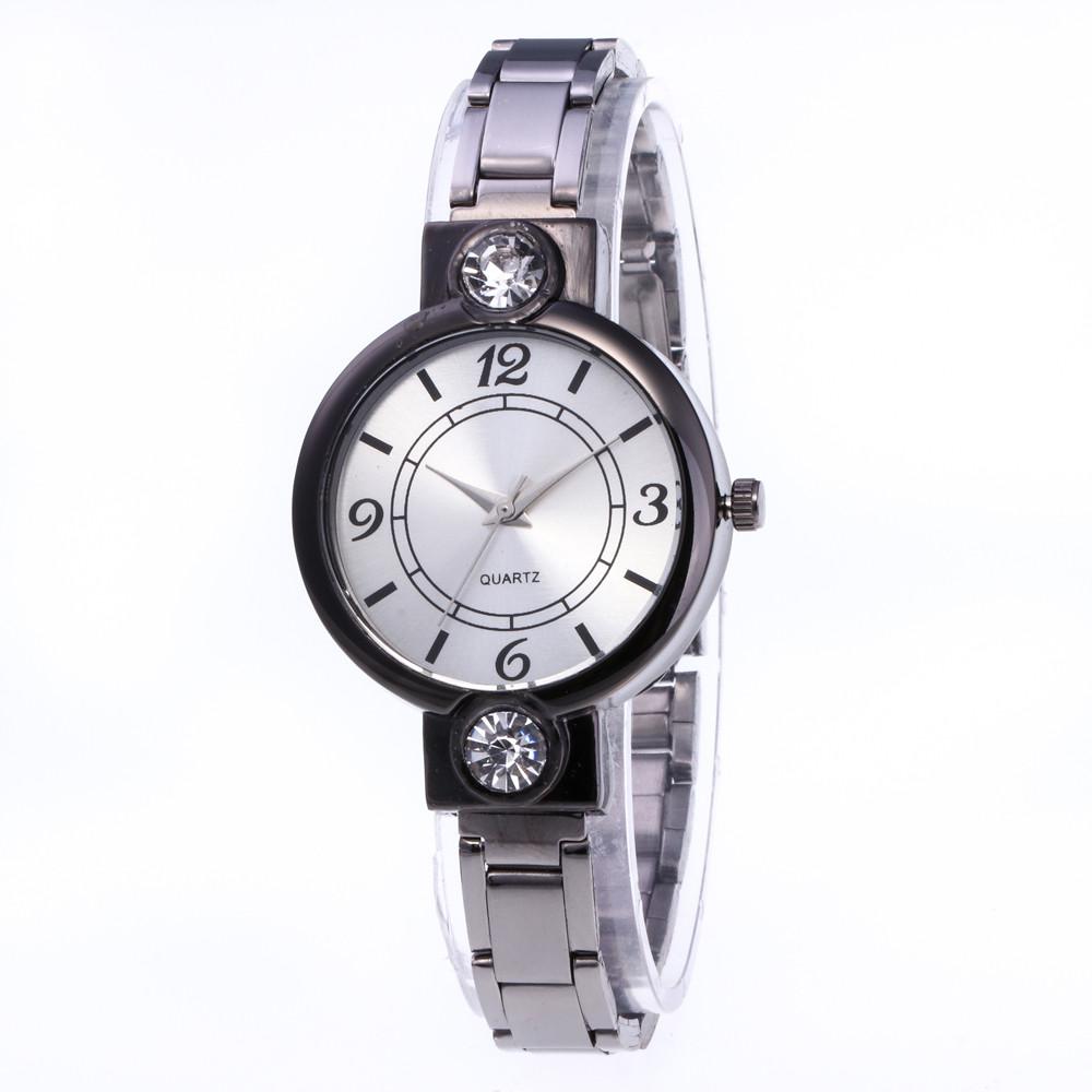 Круглые металлические часы «Quartz» чёрного цвета купить. Цена 285 грн