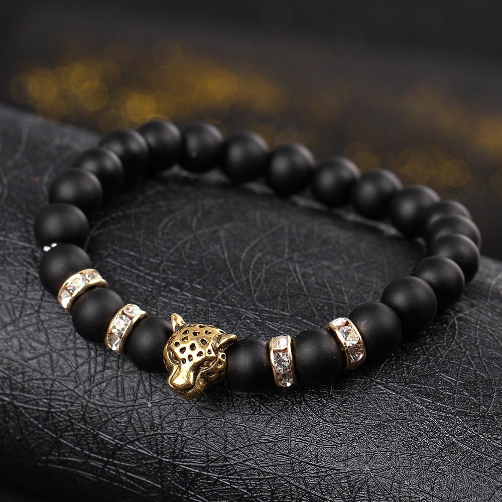 Недорогой браслет «Ягуар» с чёрными бусинами на резинке купить. Цена 55 грн