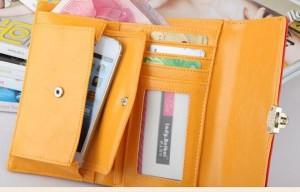 Небольшой фиолетовый кошелёк из заменителя кожи с застёжкой-клипсой фото 1