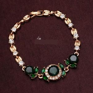 Нарядный браслет «Лесная фея» с камнями зелёного цвета, стразами и покрытием под золото купить. Цена 160 грн