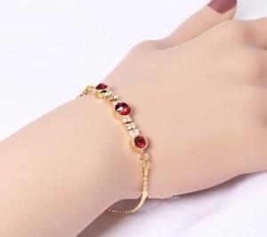 Замечательный браслет «Рубиновый» (бренд-ITALINA) с камнями Сваровски красного цвета и золотым напылением фото 1