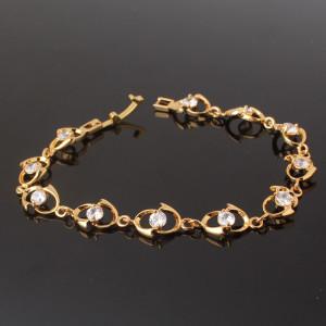 Модный браслет «Аврора» с прозрачными камнями Swarovski и покрытием из жёлтого золота купить. Цена 299 грн или 935 руб.