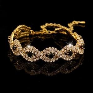 Нарядный браслет «Офелия» с кристаллами и чёрными стразами в жёлтом металле купить. Цена 150 грн или 470 руб.