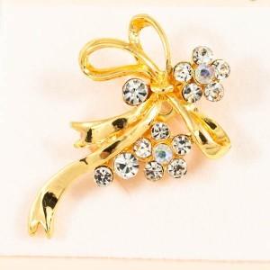 Очаровательная брошь «Юбилей» в жёлтом металле с прозрачными стразами купить. Цена 89 грн