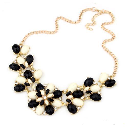 Стильное ожерелье «Франческа» с чёрно-белыми стразами в золотистом металле купить. Цена 215 грн
