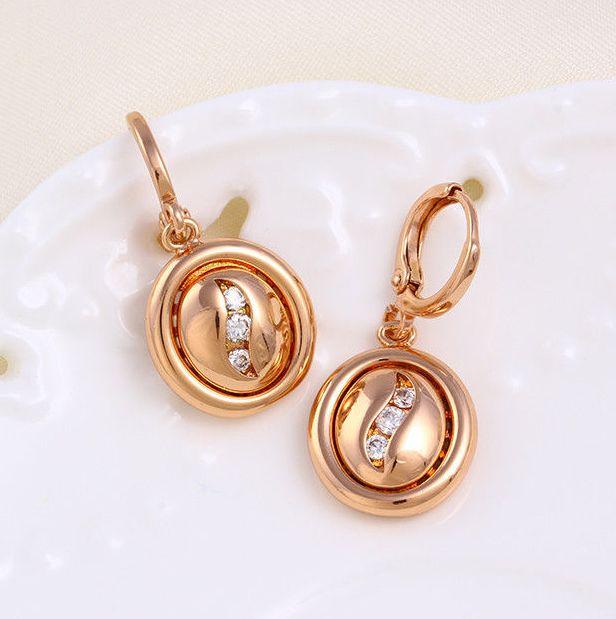 Висячие серьги «Медальоны» овальной формы с маленькими фианитами и розовой позолотой купить. Цена 155 грн