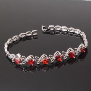 Элитный браслет «Альмадины» с красными фианитами и платиновым напылением купить. Цена 380 грн